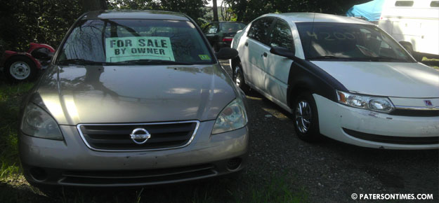 ... settlement and fees for scamming used car buyers, according the New