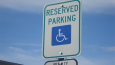 handicap-pole-with-reserved-parking-sign