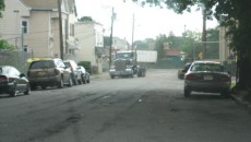 A garbage truck entering Genessee Avenue from West Railway Avenue in the wrong direction.
