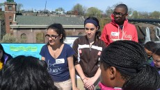 10th graders Ivette Biascochea, Kassandra Fred, and Zynief Davis (right to left) explaining the scarcity of freshwater on earth.