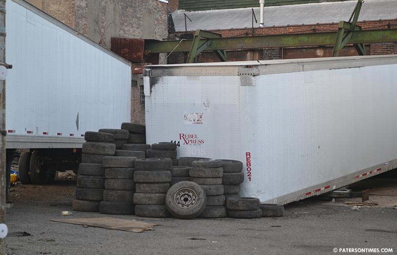 shady-street-tire-stuffed-building