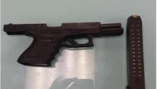 9 mm Glock handgun with 30 round high capacity magazine