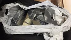 Bricks of heroin seized at 20 Laurel Hills in Manhattan.