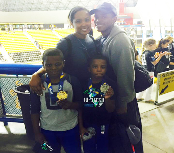 jason-and-jalen-with-family-after-medal-win