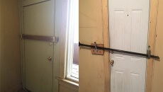 Image shows front and back doors fortified with block of wood and metal bar.