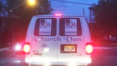 Image showing the church van in question with two Mimms campaign posters on the rear windows.