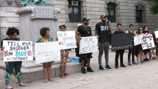 Black Lives Matter protesters with signs in front of City Hall in Paterson.