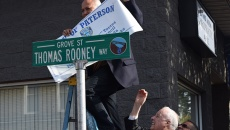 "Mayor Jose ""Joey"" Torres unveils new street sign honoring councilman Thomas Rooney."