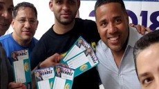 Alex Mendez in photo with vouchers.