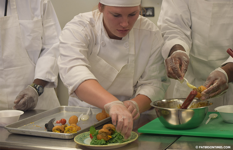 Aspiring Chefs Of Evas Village Culinary School Show Off Cooking