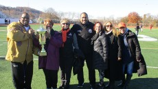 Mayor Jane Williams-Warren (second to left) holds championship trophy with superintendent Eileen Shafer (third from left) before the game.