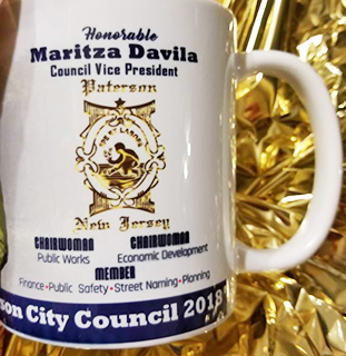 "The coffee that misidentifies Davila as the ""Council Vice President."""