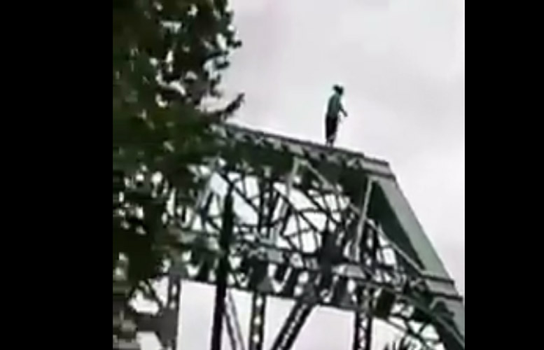 woman-jumps-from-straight-street-bridge