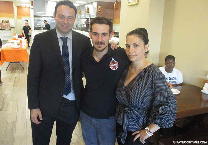 Mayor Andre Sayegh with the owners of the new Galata Butcher Deli Grill, Serhan and Linda Belgi, at the restaurant's grand opening.