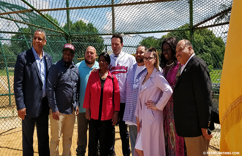 The couple, pictured right of Sayegh, pose for photograph with municipal officials and the chairman, after the donation announcement.