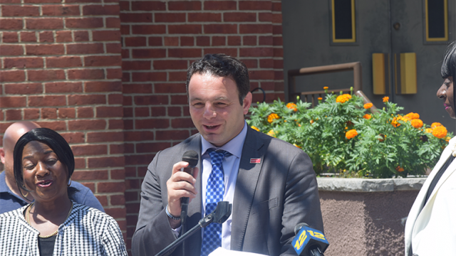 Sayegh announces his road repair plan in front of the St. Bonaventure's Church on Ramsey Street.