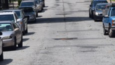 The worn-out and damaged blacktop on Danforth Avenue.