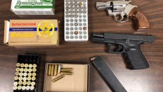 Weapons and ammo seized in bust.
