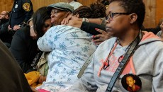 The mother, Naomi Simmons, in light green hat, tears up after verdict.