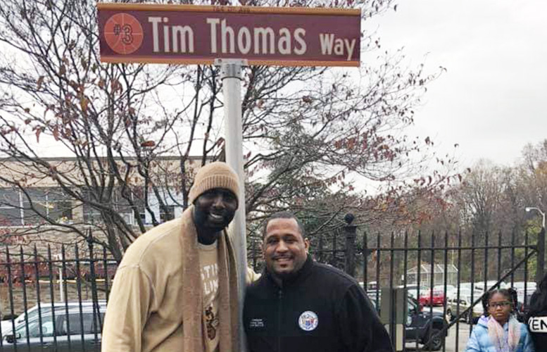 Tim Thomas (left) with school board member Emanuel Capers (right).