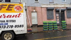 Crates of Mountain Dew unloaded at the corner of 16th Avenue and Carroll Street.