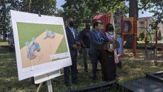 A rendering of the new playground in the forefront as the mayor delivers remarks during the groundbreaking on Thursday.